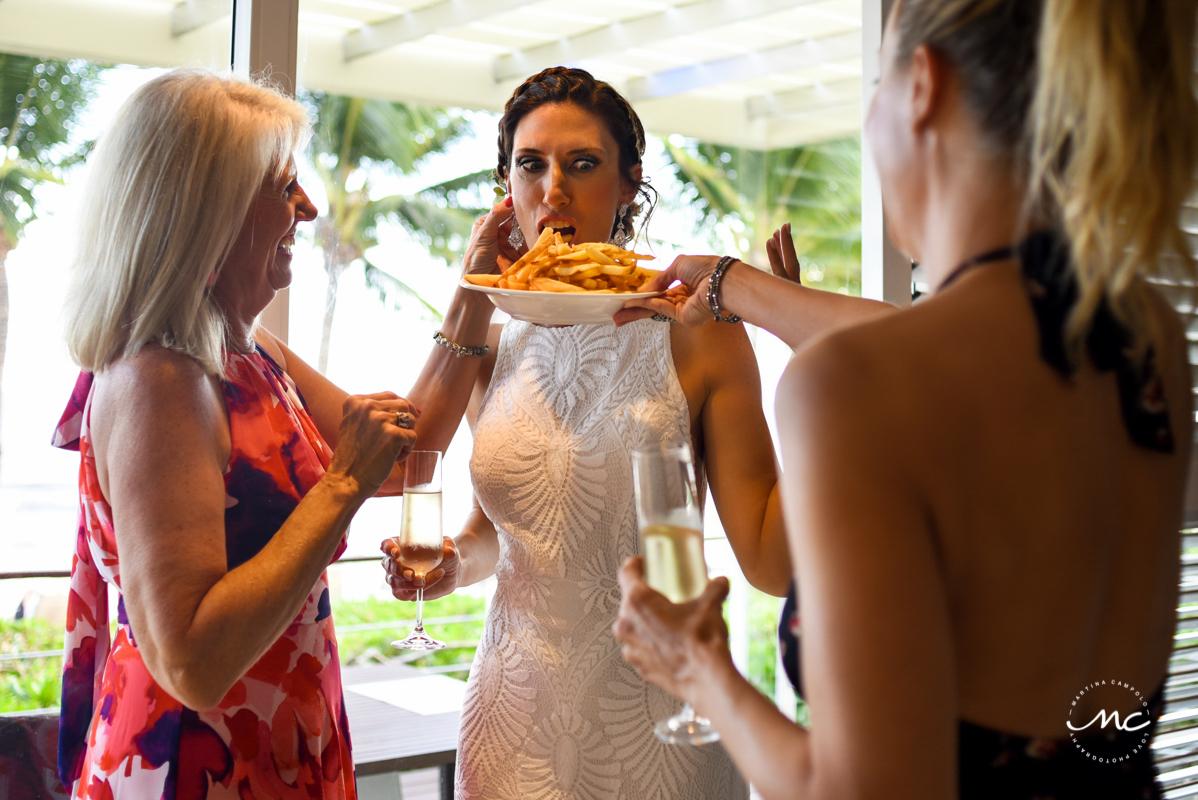 Funny bride shot with french fries at Blue Diamond Riviera Maya Wedding. Martina Campolo Photography