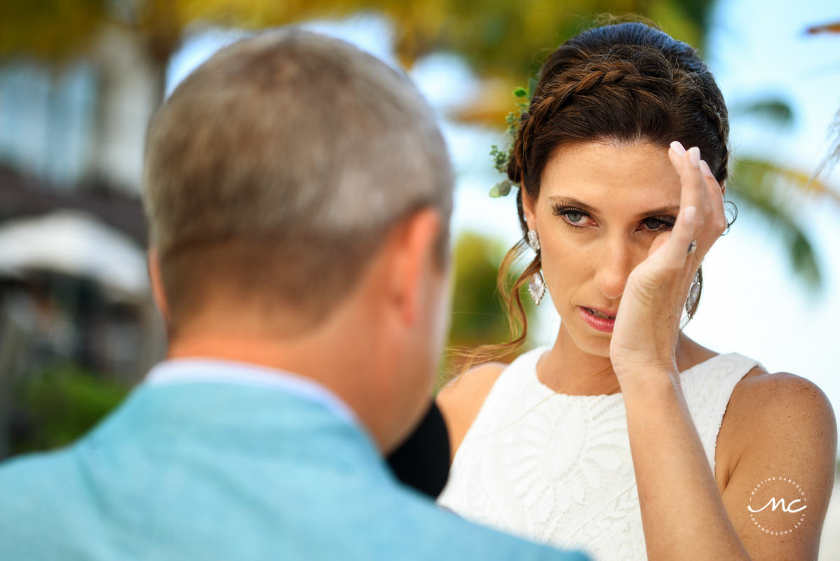 Emotional bride during Blue Diamond Riviera Maya Beach Wedding in Mexico. Martina Campolo Photography