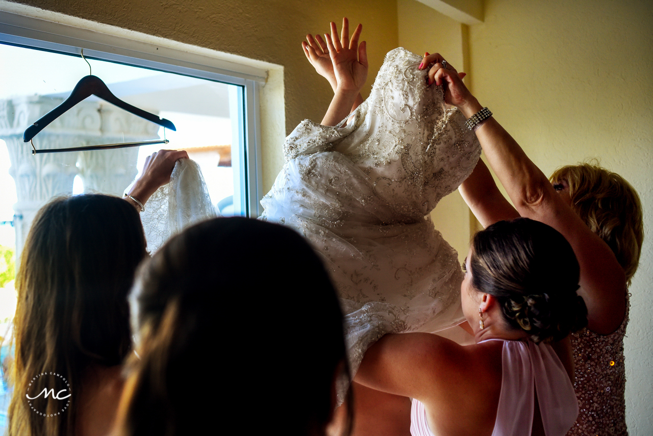 Bride getting in dress, The Royal Playa del Carmen Wedding. Martina Campolo Photography