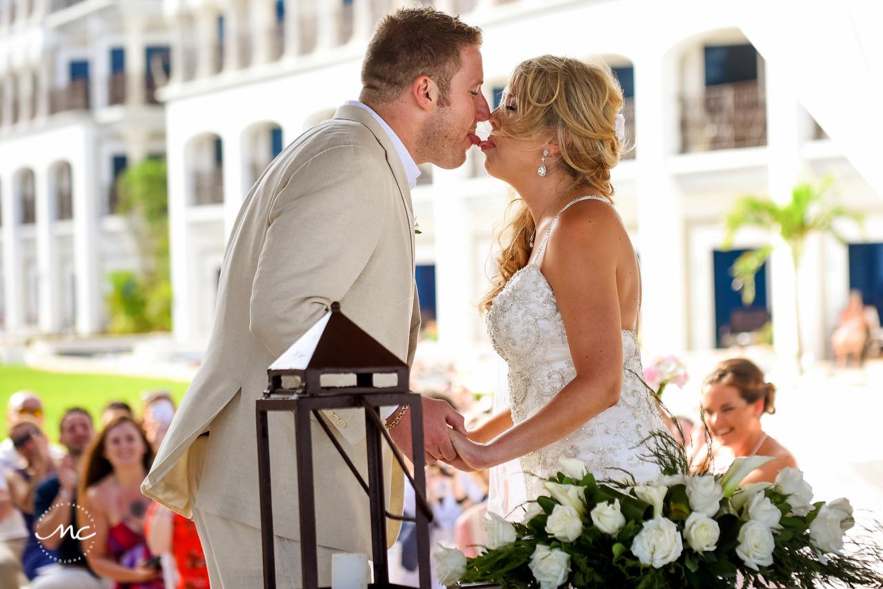 Bride and groom first kiss. The Royal Playa del Carmen Wedding. Martina Campolo Photography