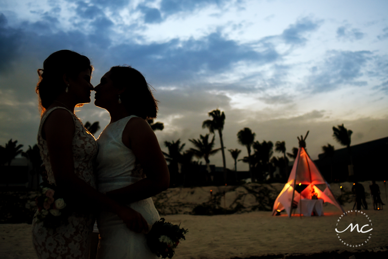 Brides silhouette at dusk. Andaz Mayakoba Wedding by Martina Campolo Photography