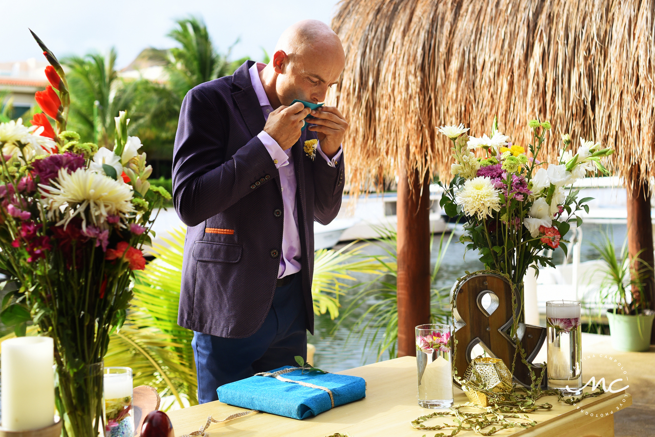 Emotional french groom opens his present. Puerto Aventuras Wedding by Martina Campolo Photography