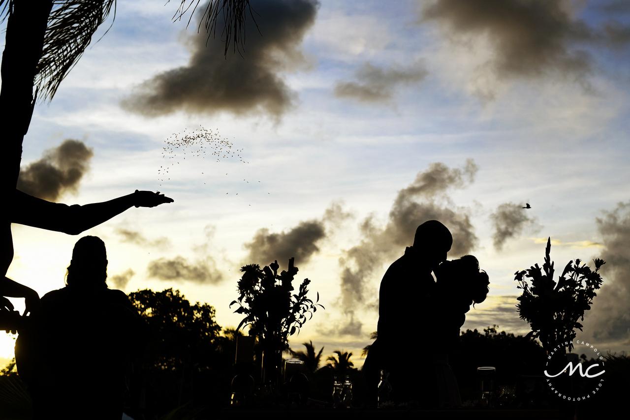 Bride and groom kiss, beautiful silhouettes by Martina Campolo Riviera Maya Photography