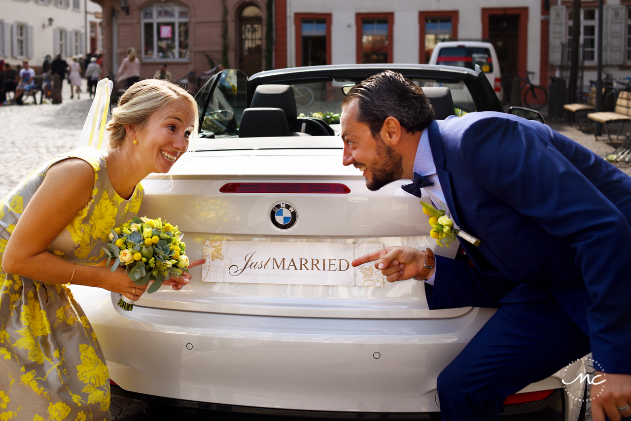 Bride and groom with Just Married Car. Heidelberg Wedding in Germany. Martina Campolo Photography