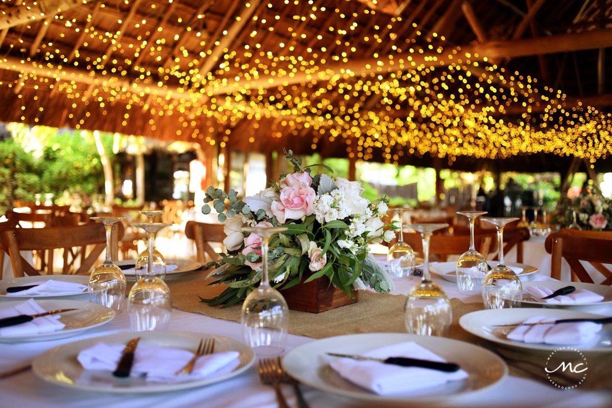 Rustic wedding reception decor with string lights at Blue Venado, Playa del Carmen. Martina Campolo Photography