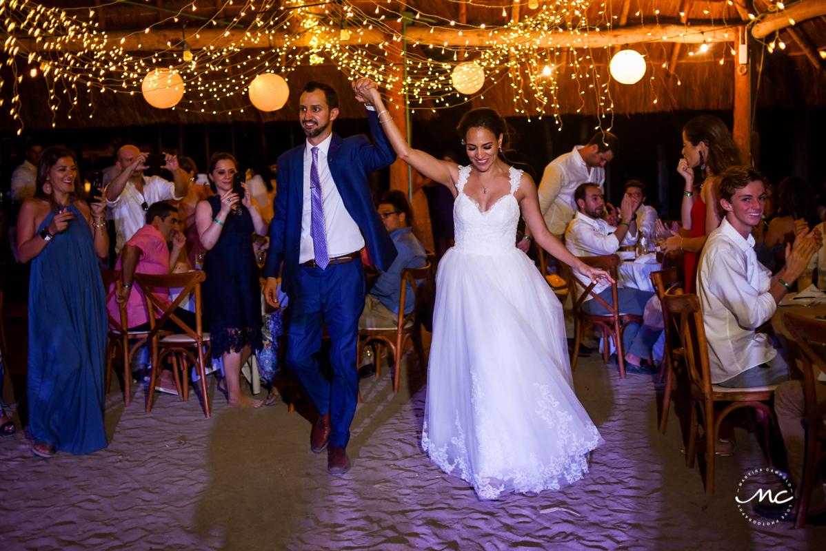 Bride and groom reception entrance at Blue Venado Beach Club in Mexico by Martina Campolo Photography