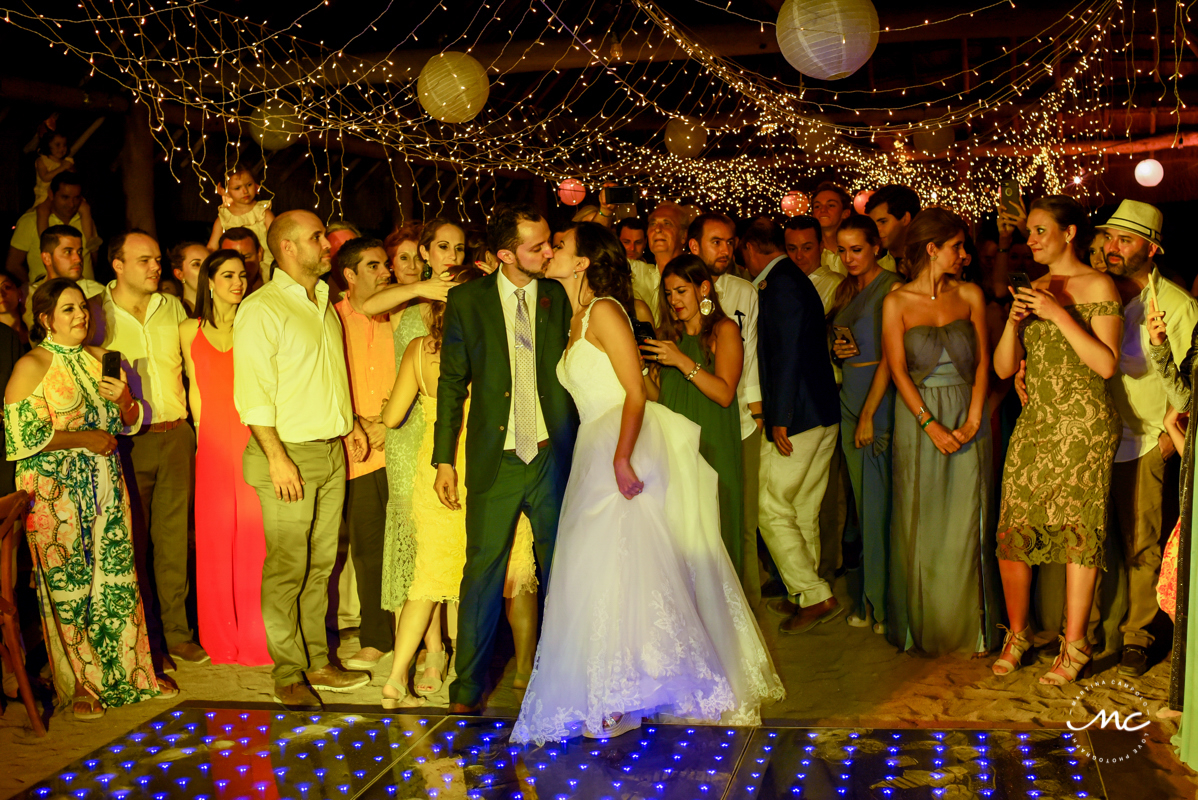 Bride and groom kiss at Blue Venado Wedding Reception in Mexico by Martina Campolo Photography