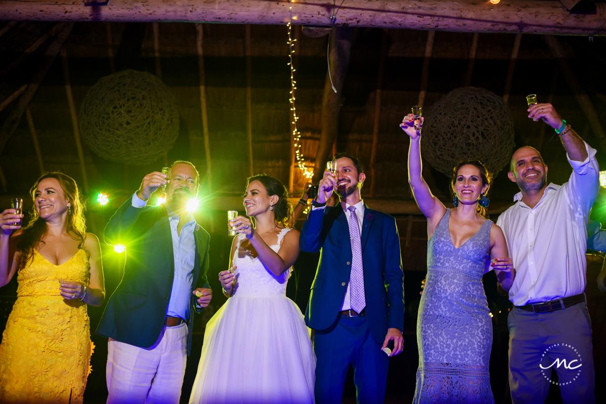 Cheers. Wedding Reception moment at Blue Venado Beach in Mexico. Martina Campolo Photography