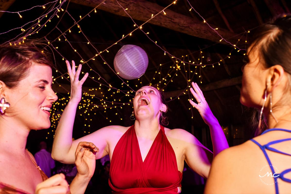 Wedding guests dance at Blue Venado Wedding in Playa del Carmen. Martina Campolo Photography