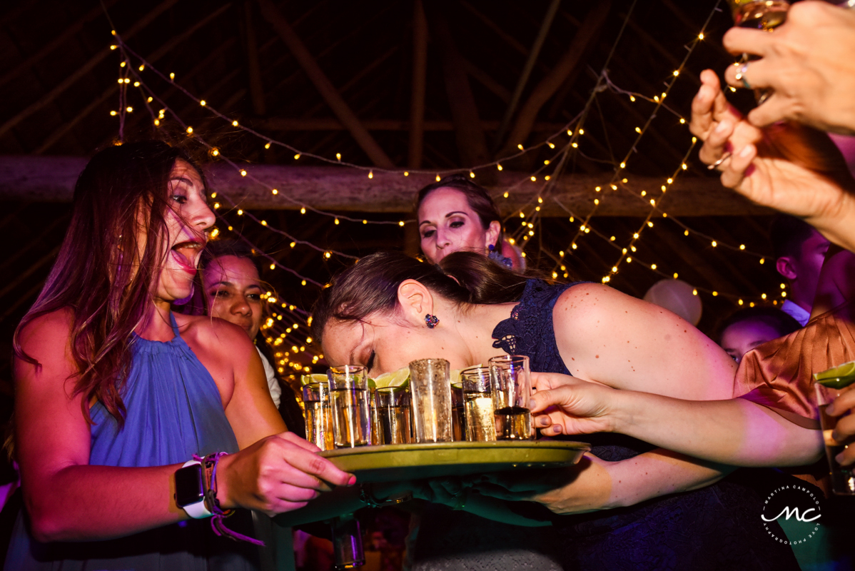 Drinking tequila shots at Blue Venado Wedding in Mexico. Martina Campolo Photography