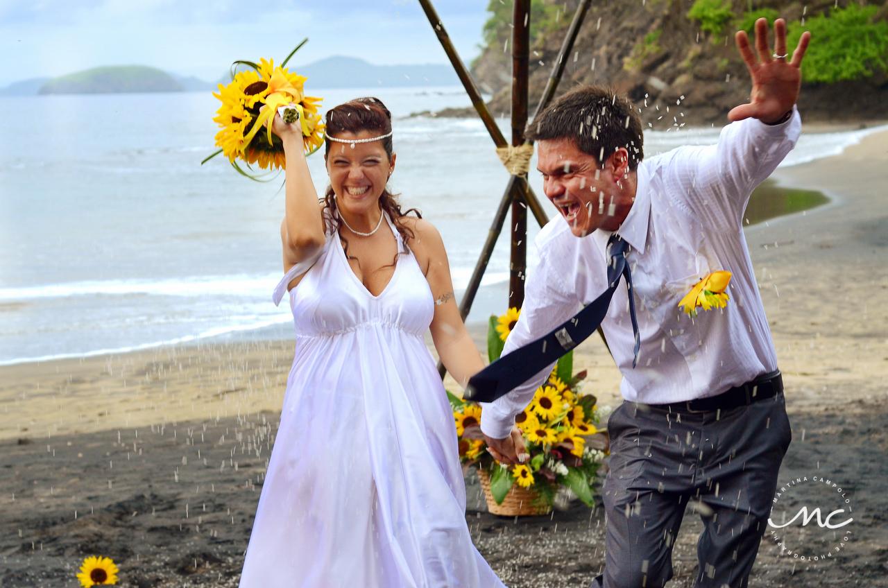 Rice toss. Playa del Coco, Costa Rica Destination Wedding. Martina Campolo Photography