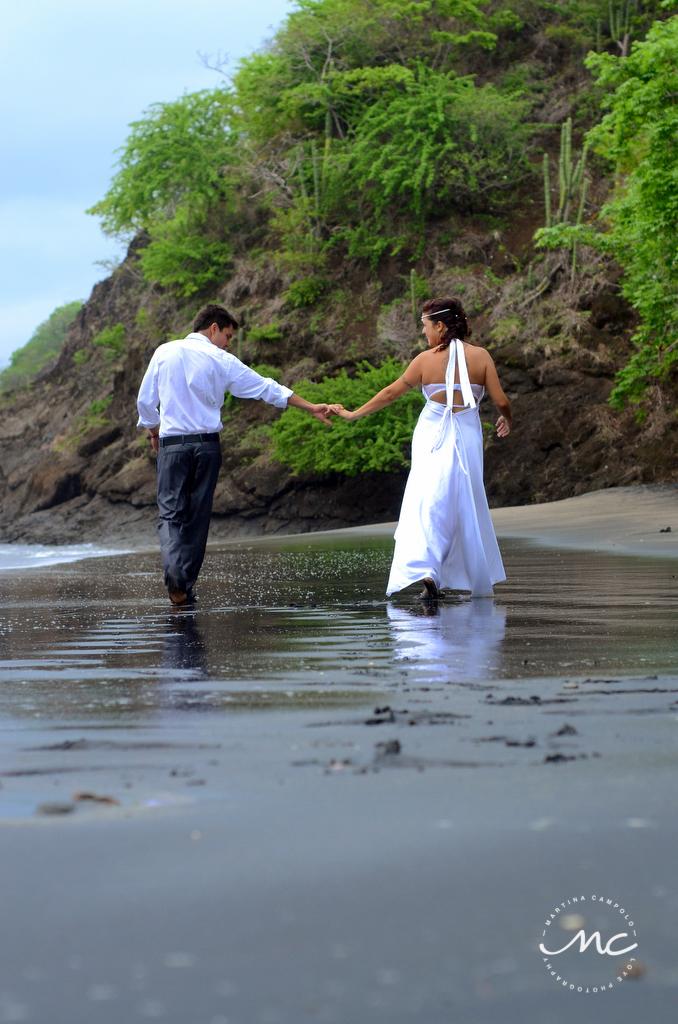 Bride and groom beach portraits in Playa Hermosa, Costa Rica. Martina Campolo Photography