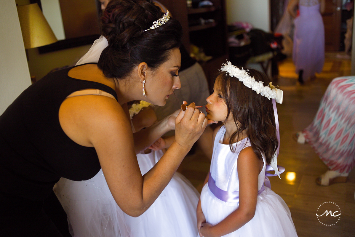 Destination bride and flower girl getting ready at Now Sapphire Hotel in Mexico. Martina Campolo Photography
