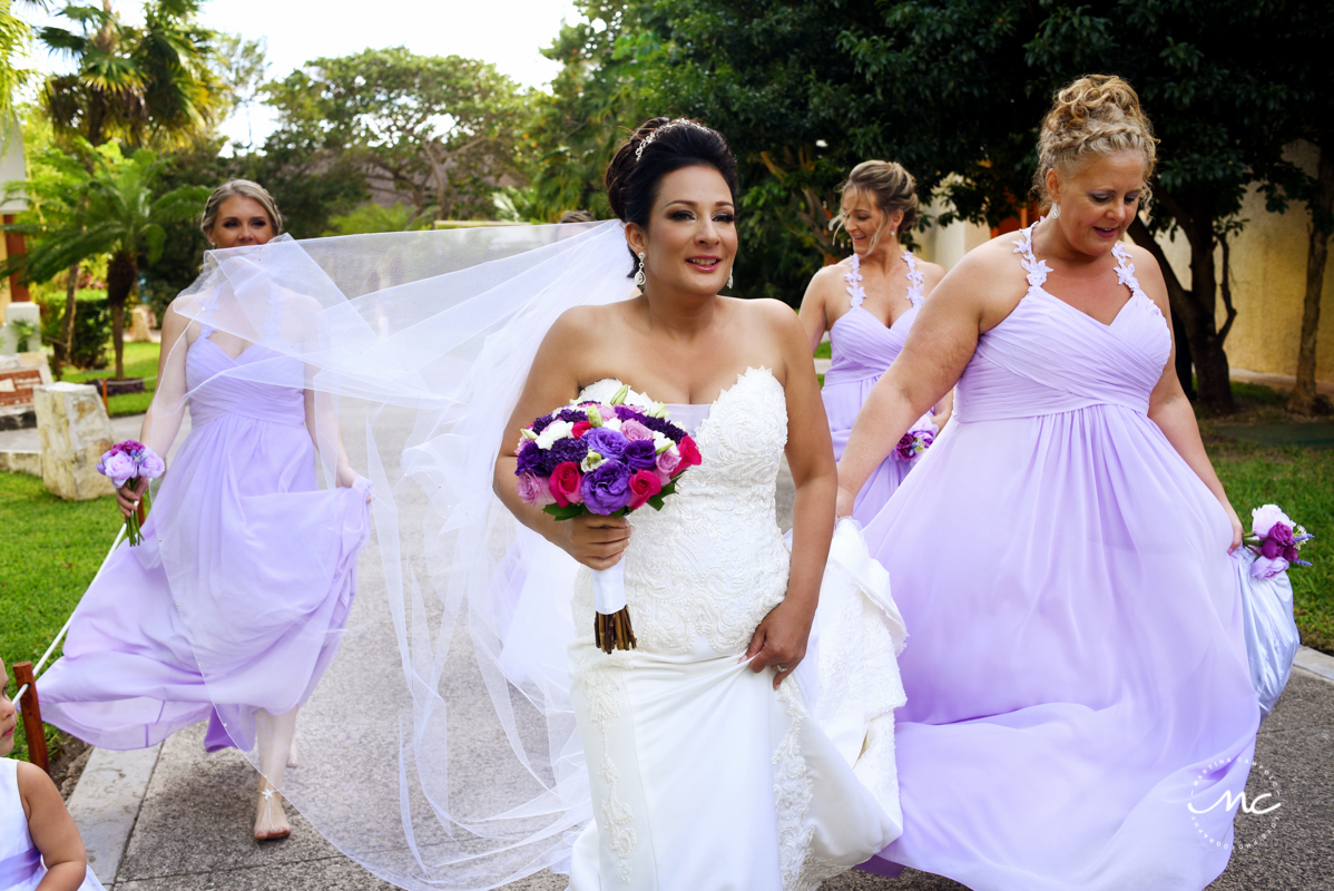 Beach bride and lilac bridesmaids. Now Sapphire destination wedding in Mexico by Martina Campolo Photography