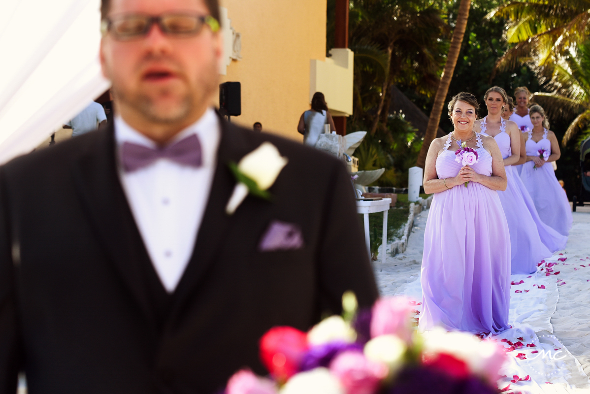 Lilac bridesmaids walk down the aisle. Now Sapphire Riviera Cancun wedding by Martina Campolo Photography