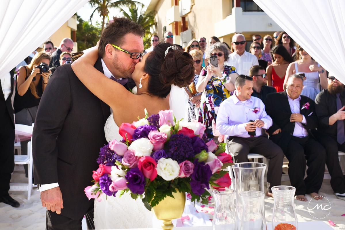 Bride and groom kiss. Martina Campolo Now Sapphire Riviera Cancun Wedding Photography