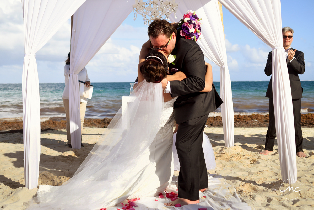 You may kiss the bride. Now Sapphire Riviera Cancun destination wedding by Martina Campolo Photography