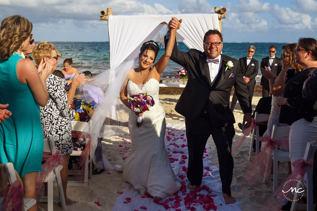 Bride and groom exit by Martina Campolo Now Sapphire Riviera Cancun Wedding Photography