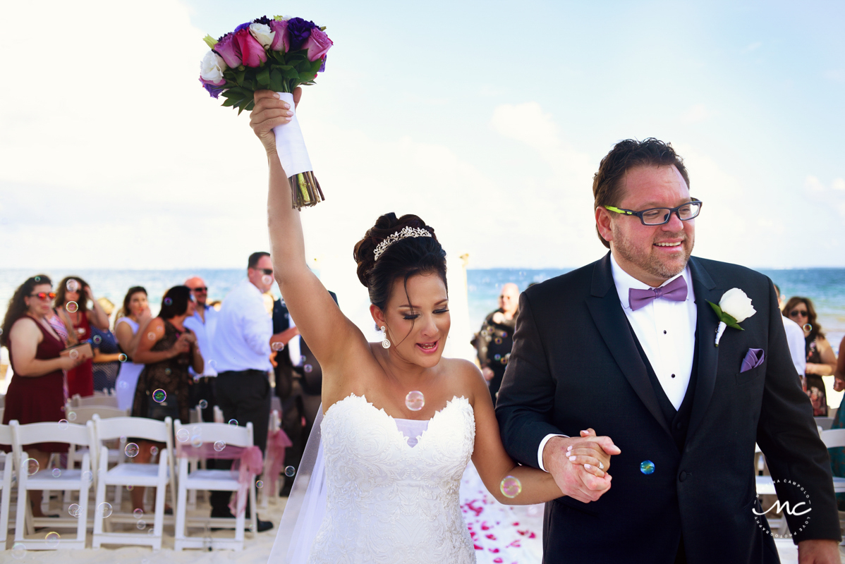 Bride and groom exit. Now Sapphire Riviera Cancun wedding by Martina Campolo Photography