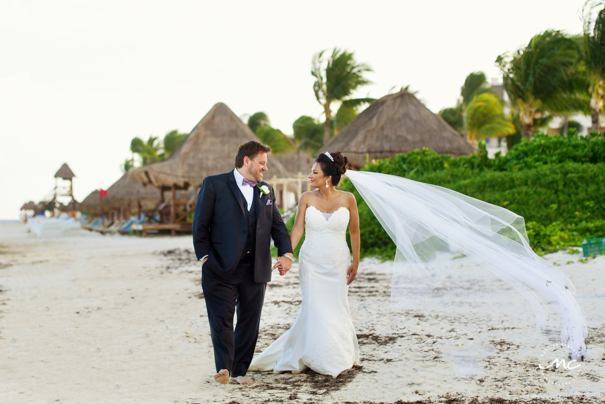 Bride and groom beach portraits at Now Sapphire Riviera Cancun, Mexico. Martina Campolo Photography