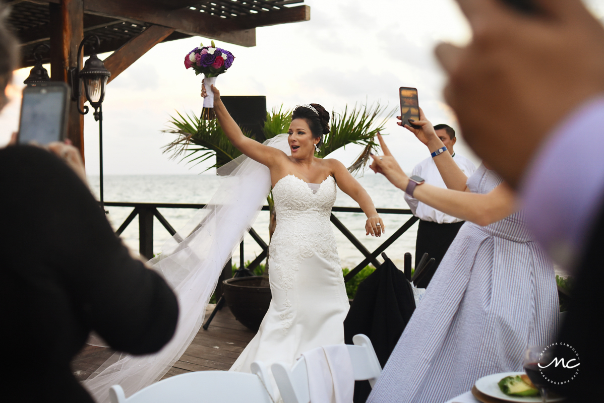 Happy bride enters wedding reception site at Now Sapphire Riviera Cancun. Martina Campolo Photography