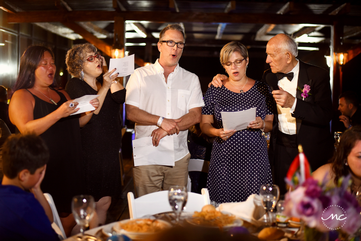 Wedding guests sing at Now Sapphire Riviera Cancun wedding. Martina Campolo Photography