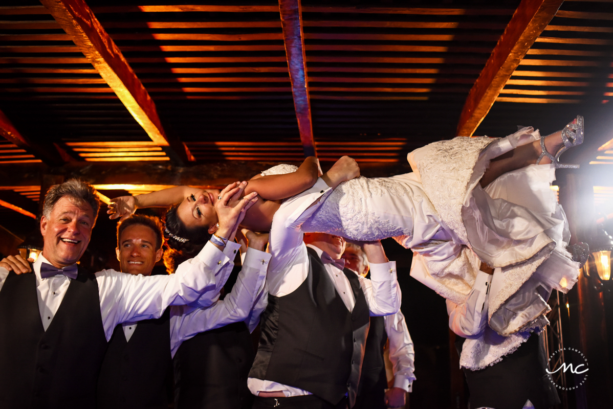 Groomsmen carry bride at Now Sapphire Riviera Cancun, Mexico. Martina Campolo Photography