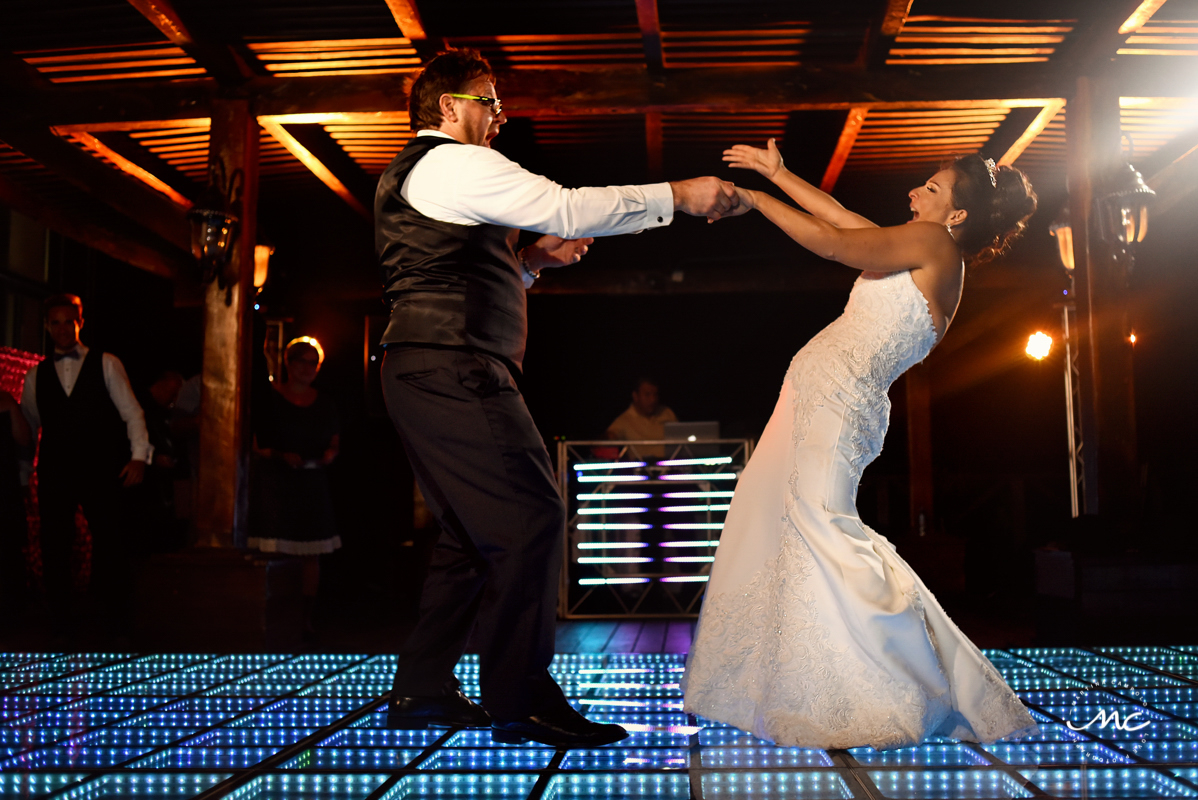 Bride and groom dance. Now Sapphire Riviera Cancun destination wedding by Martina Campolo Photography