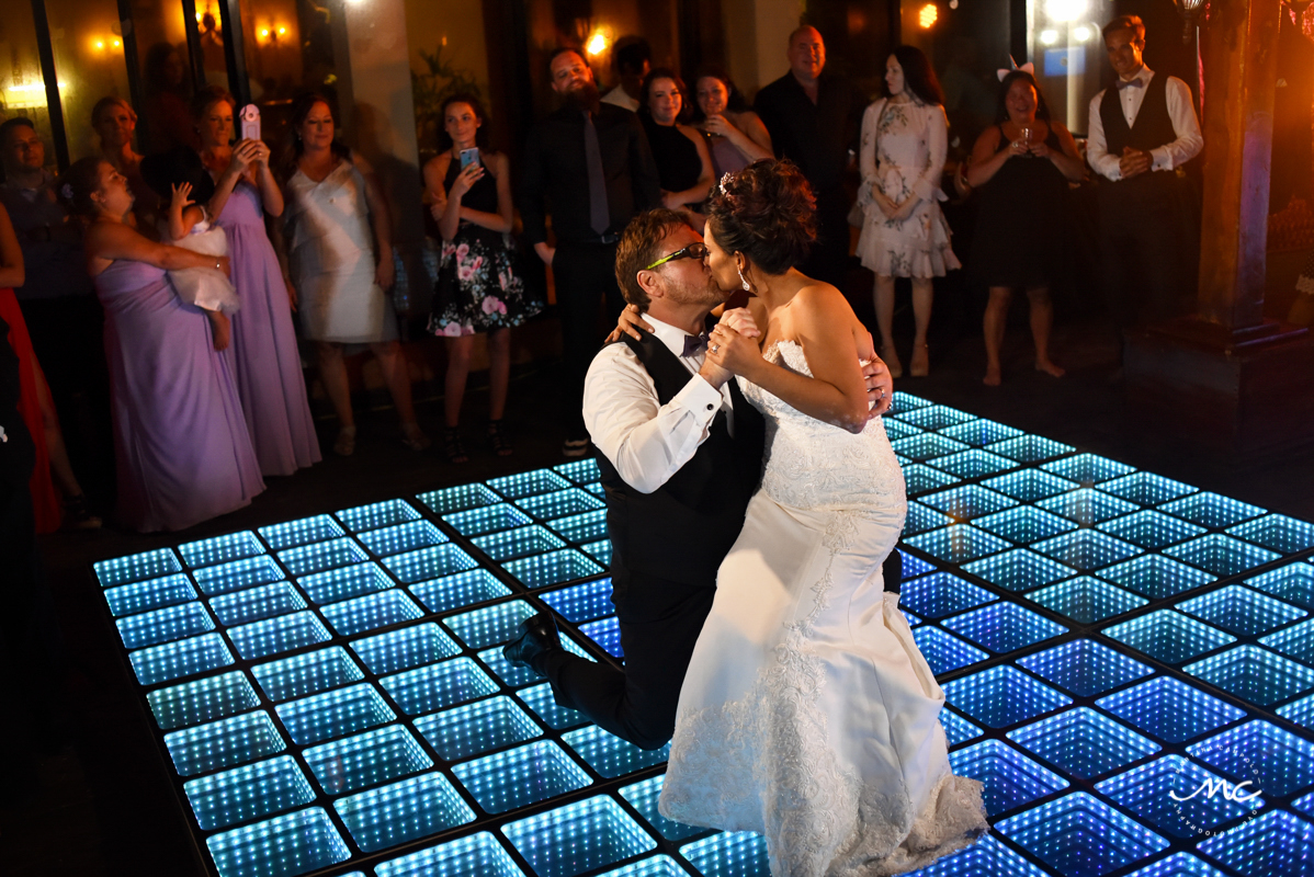 Bride and groom dance on infinity dance floor. Now Sapphire Riviera Cancun wedding by Martina Campolo Photography