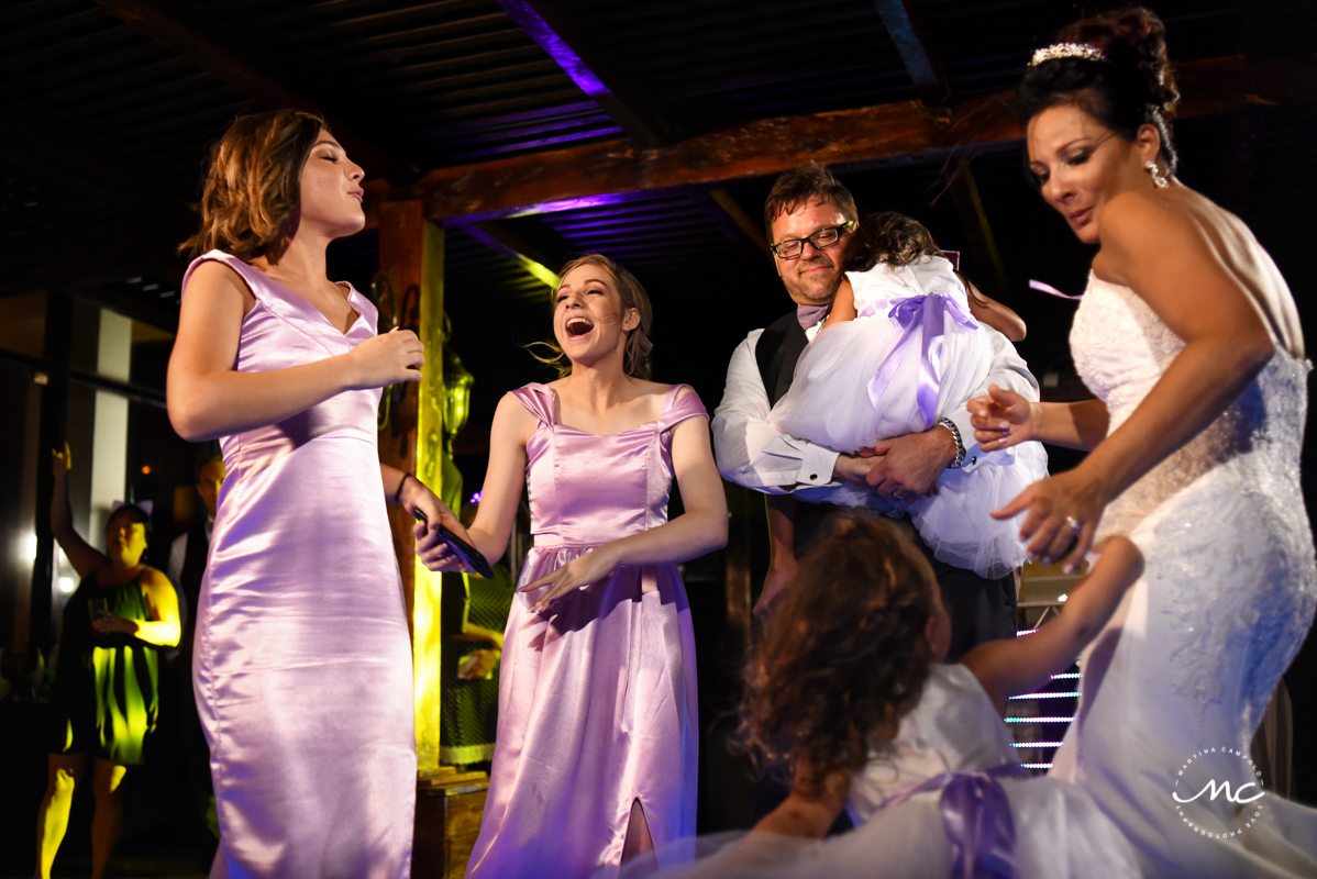 Bride, groom and family. Now Sapphire Riviera Cancun wedding reception by Martina Campolo Photography