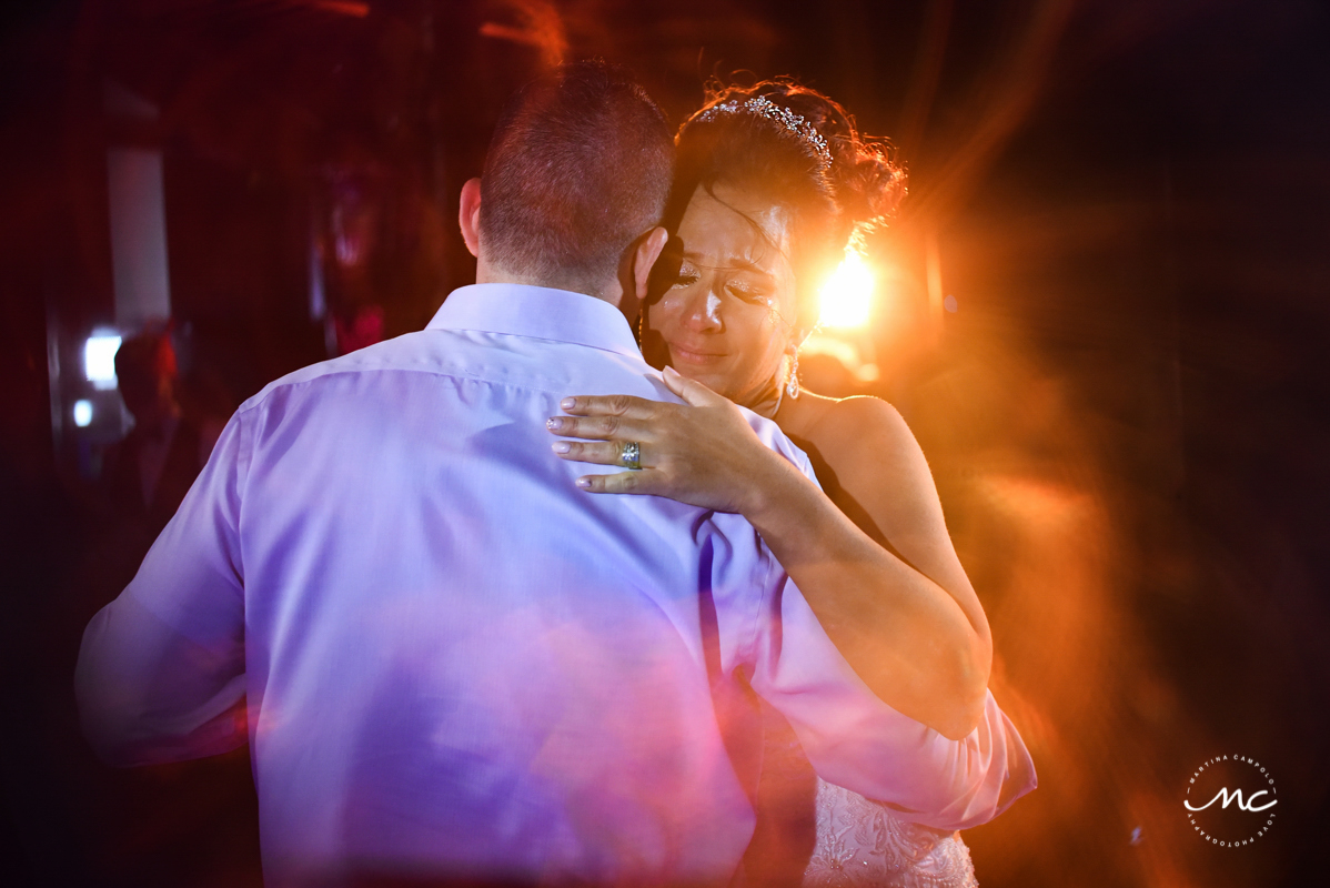 Emotional bride. Now Sapphire Riviera Cancun wedding reception by Martina Campolo Photography