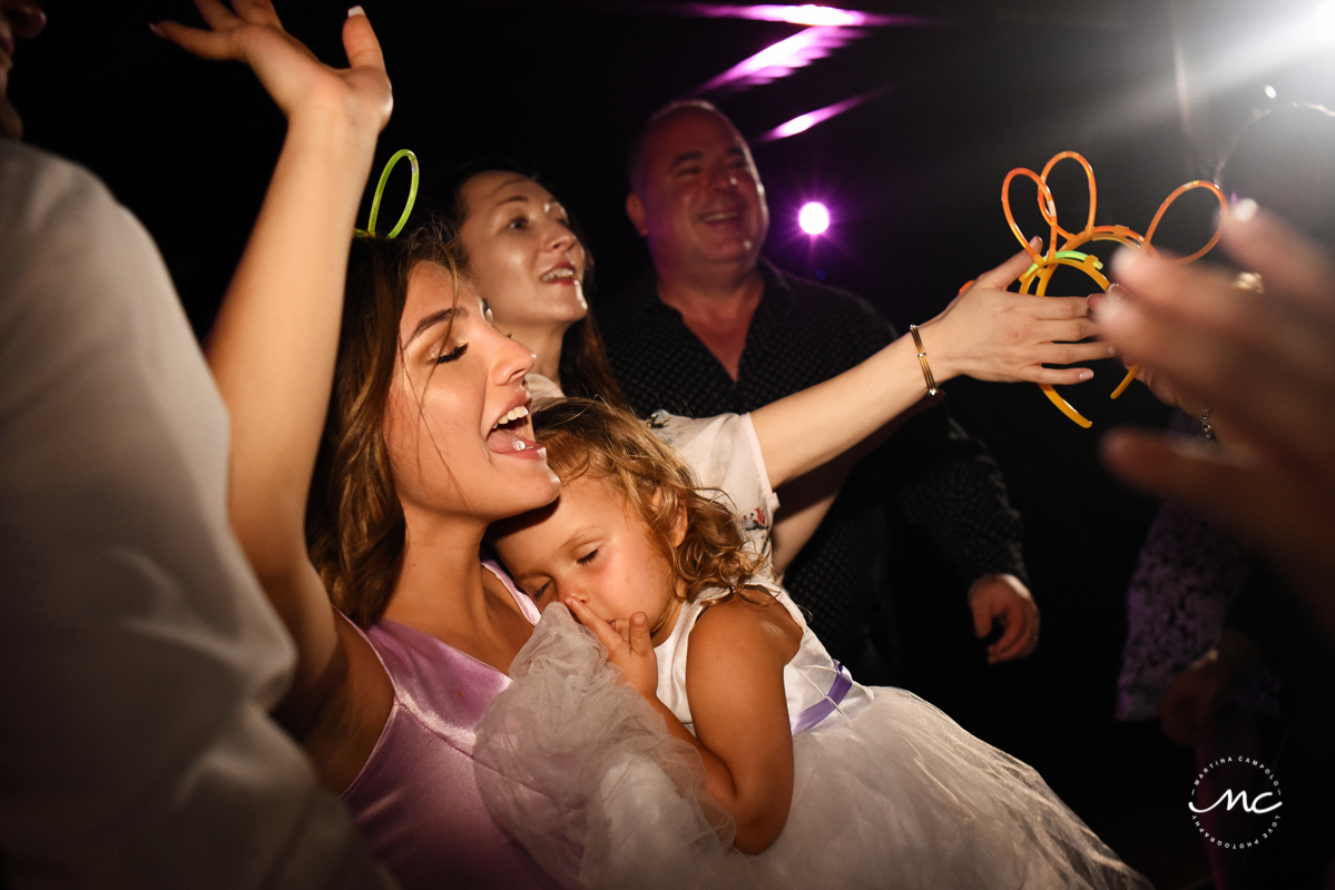 Flower girl sleeps during Now Sapphire Riviera Cancun wedding reception. Martina Campolo Photography