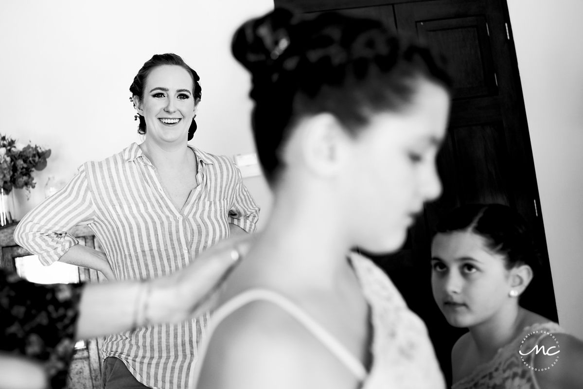 Black and white photo of bride getting ready for her Hacienda del Mar wedding in Mexico. Martina Campolo Photography