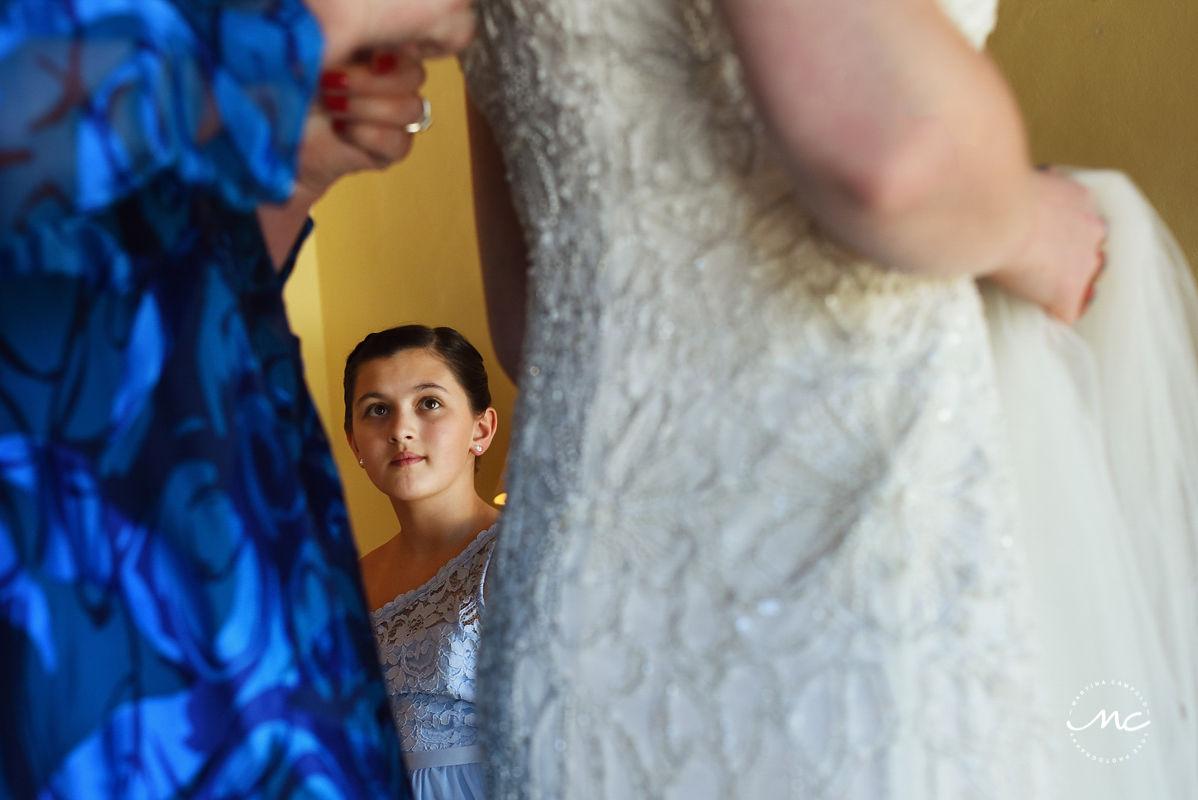 Girl watching bride getting dressed. Hacienda del Mar destination wedding in Mexico by Martina Campolo Photography