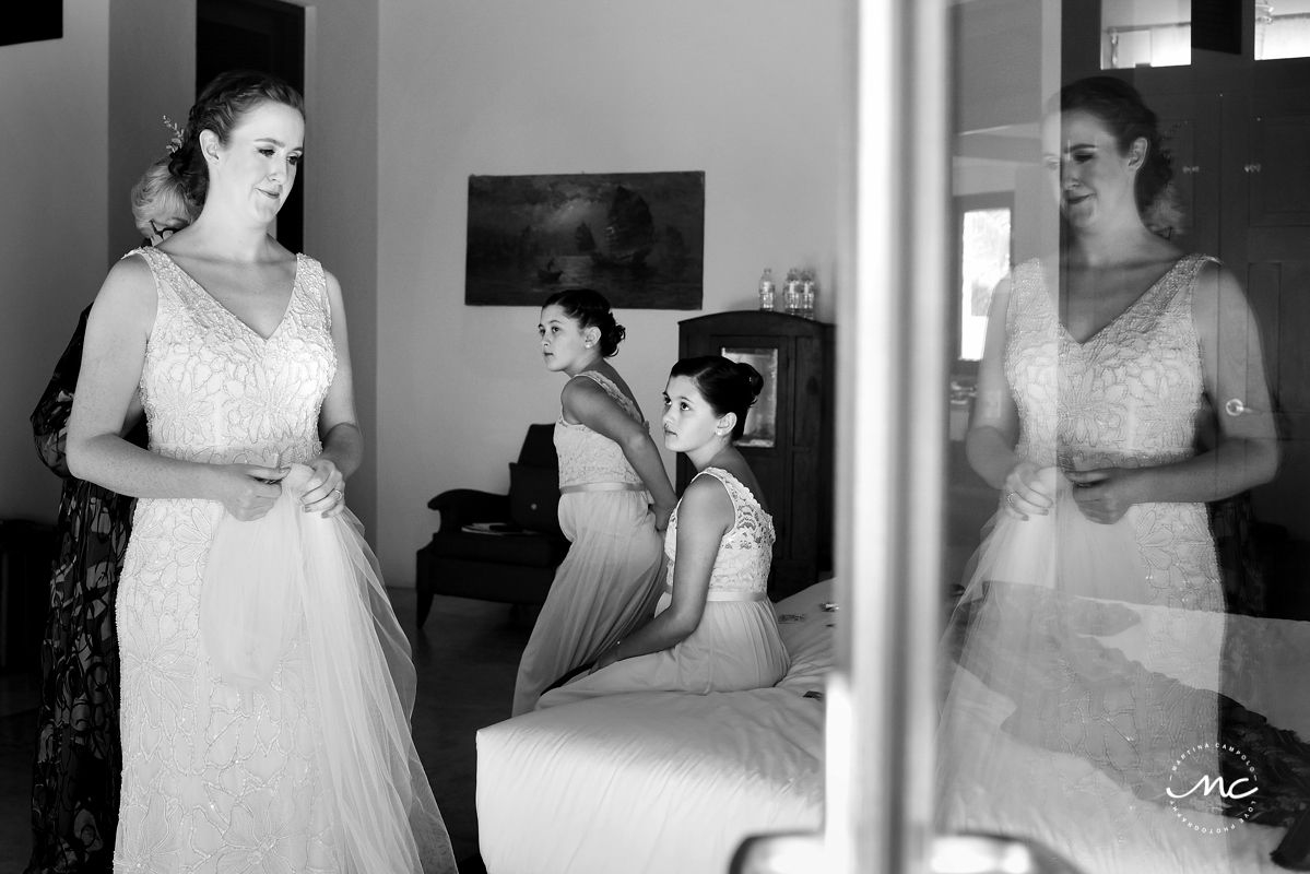 Black and white photo of bride getting ready at Hacienda del Mar, Puerto Aventuras, Mexico. Martina Campolo Photography