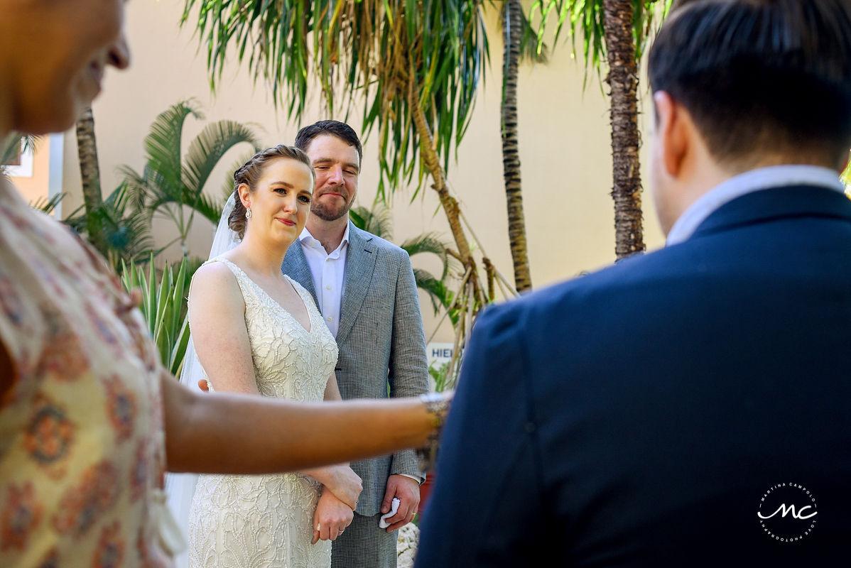 Wedding guest reading at ceremony. Hacienda del Mar, Riviera Maya, Mexico. Martina Campolo Photography