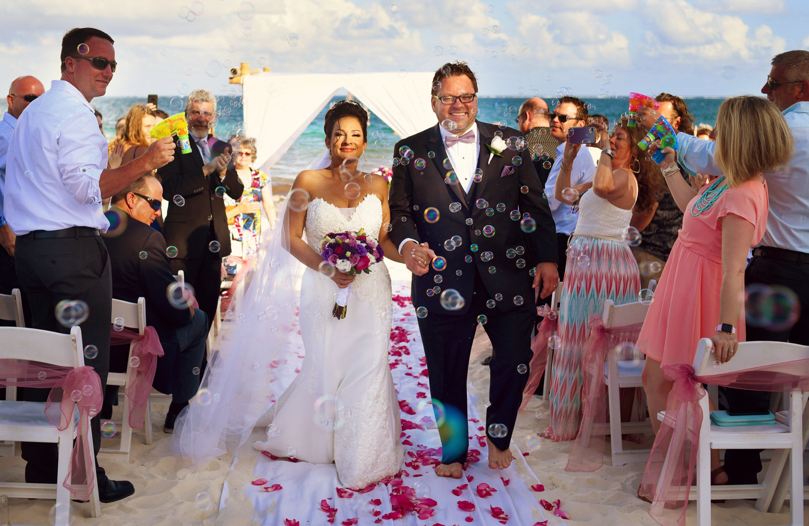 Bride and groom sunset portraits on infinity dance floor. Now Sapphire wedding by Martina Campolo Photography